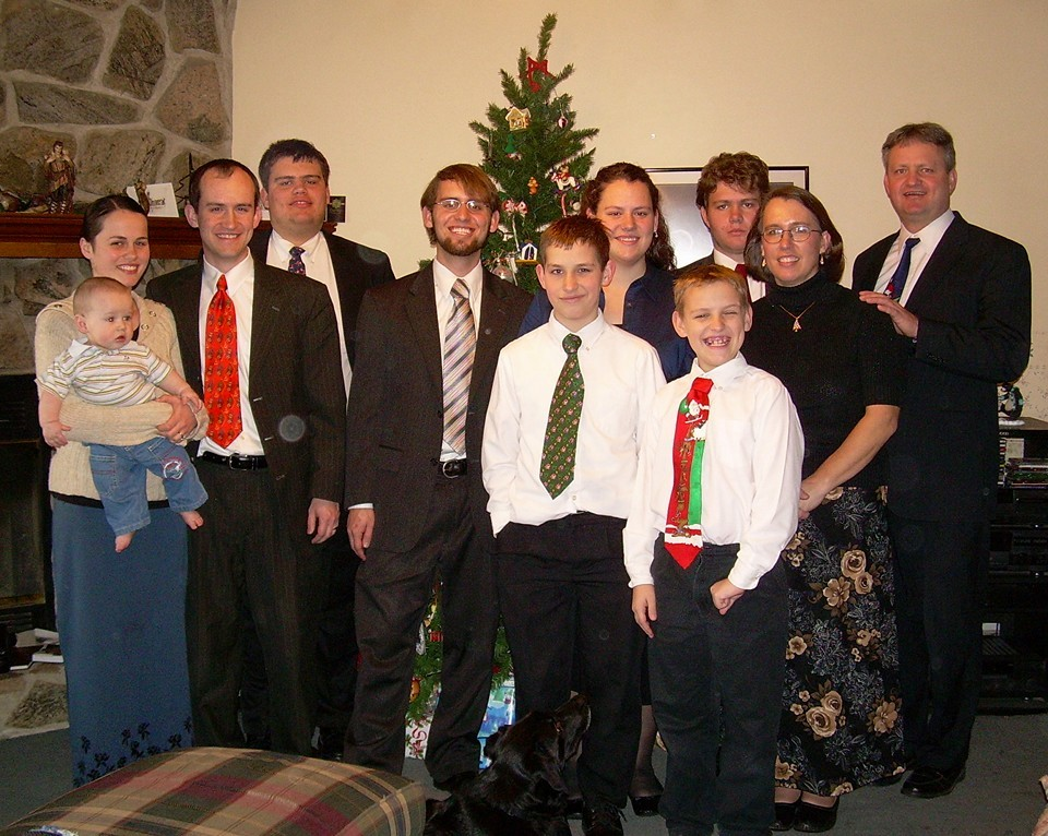 Kendall Pack's family in front of the Christmas tree.