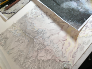 In process photo of transferring grid information from map to drawing